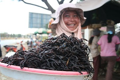 Woman selling fried tarantula spiders in Cambodia